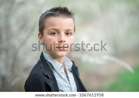 Portrait of a handsome boy outdoors #1067611958