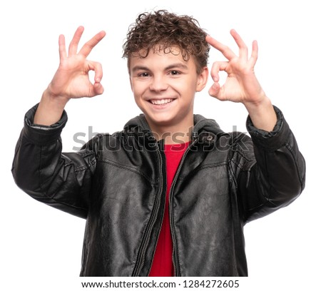 9f48cf72f0 Portrait of a Handsome brutal Teen Boy in a black Leather Jacket. Smiling  fashion Child