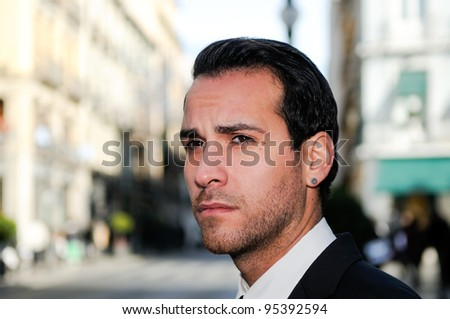 Portrait of a handsome businessman in the street
