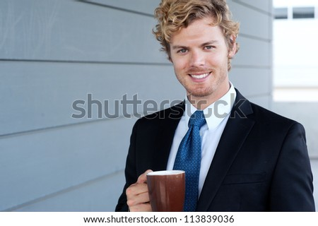 portrait of a handsome businessman with coffee mug