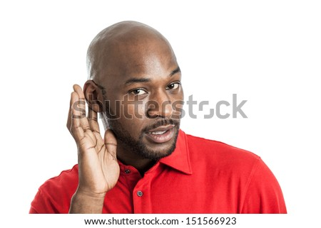 Portrait of a handsome excited black man in his late 20s cupping ear listening isolated on white