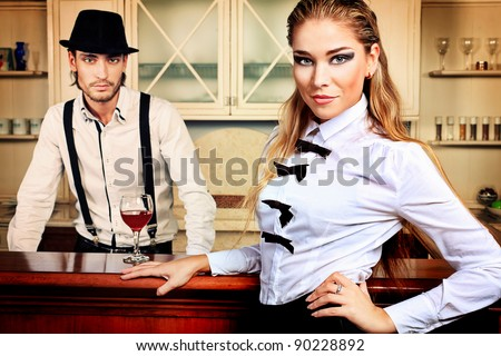 Portrait of a handsome fashionable man with  charming woman posing in the interior.