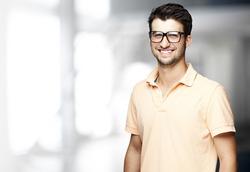 portrait of a handsome happy man indoor