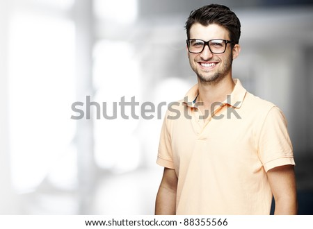 portrait of a handsome happy man indoor