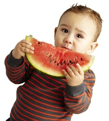 portrait of a handsome kid holding a watermelon over white background
