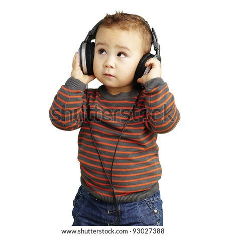 portrait of a handsome kid listening to music looking up over white