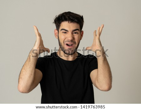 Portrait of a handsome latin young man surprised and shocked hearing great news. Attractive male looking amazed with wide eyes and mouth open in surprise. Human facial expressions and emotions. #1419763985