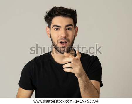 Portrait of a handsome latin young man surprised and shocked hearing great news. Attractive male looking amazed with wide eyes and mouth open in surprise. Human facial expressions and emotions. #1419763994