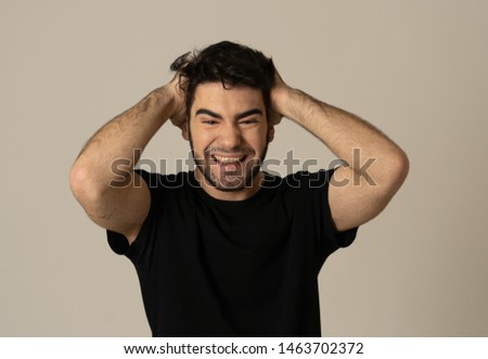 Portrait of a handsome latin young man surprised and shocked hearing great news. Attractive male looking amazed with wide eyes and mouth open in surprise. Human facial expressions and emotions. #1463702372