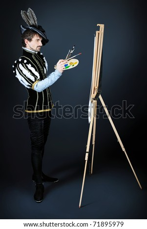 Portrait of a handsome man artist in 16th century costume. Shot in a studio.