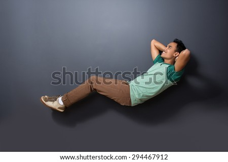 Portrait Of A Handsome Man Floating With Sleeping Pose Isolated On Dark Background 294467912