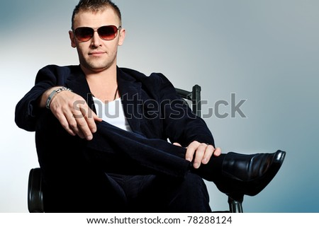 Portrait of a handsome man in sunglasses. Studio shot.