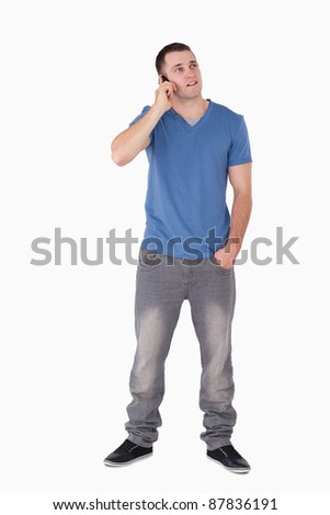 Portrait of a handsome man making a phone call against a white background