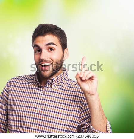portrait of a handsome man pointing up with finger