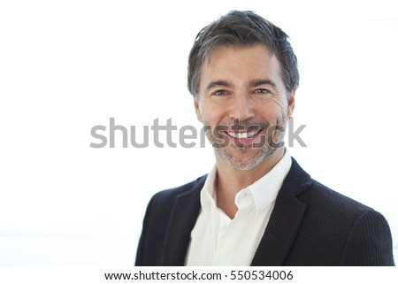 Portrait Of A Handsome Man Smiling Isolated On White #550534006
