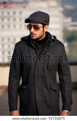 portrait of a handsome man wearing over coat - stock photo
