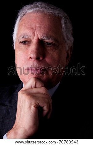 Portrait of a handsome mature businessman,  on black background, studio shot - stock photo