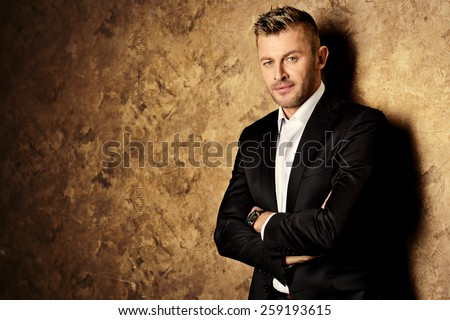 Portrait of a handsome mature man in elegant suit. Fashion, beauty.