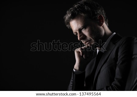 Portrait of a handsome mature man lost in deep thought