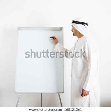 Portrait of a handsome Middle Eastern businessman giving presentation.