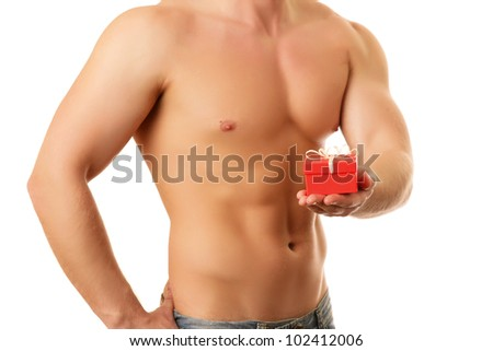 Portrait of a handsome muscular young man holding a present.