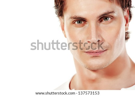 Portrait of a handsome muscular young man. Isolated over white background.