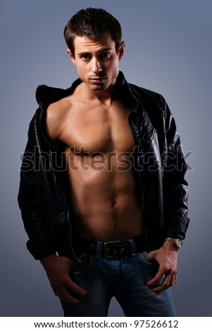 Portrait of a handsome muscular young man. Shot in a studio