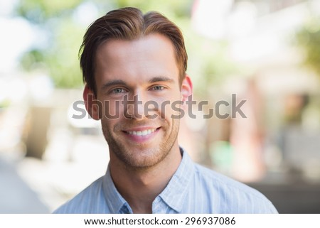 Portrait of a handsome smiling man looking at the camera #296937086