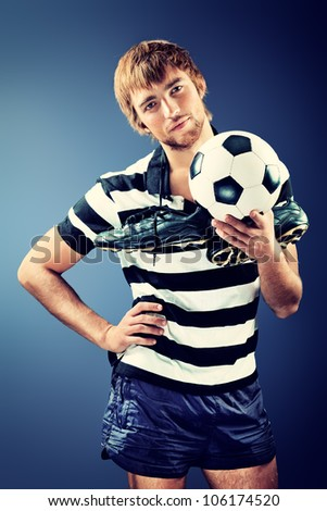 Portrait of a handsome soccer player. Studio shot.