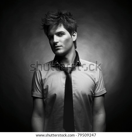 Portrait of a handsome stylish man with a cool hairstyle