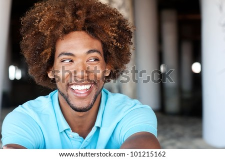 portrait of a handsome young African American man at the beach