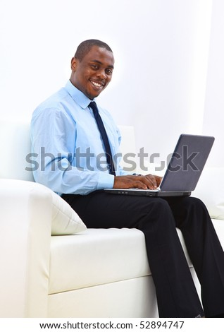 Portrait of a handsome young business man looking away and thinking