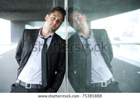 Portrait of a handsome young business man outdoors