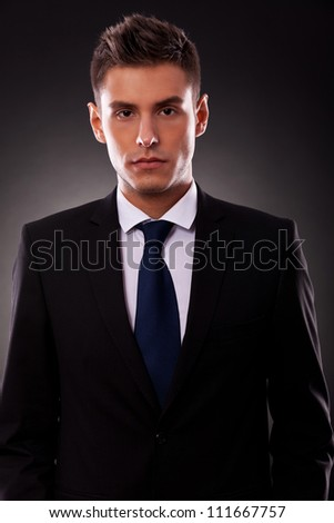Portrait of a handsome young businessman looking seriously at camera