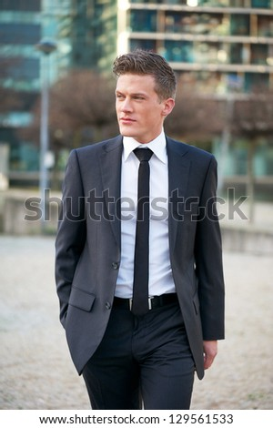 Portrait of a handsome young businessman walking outdoors