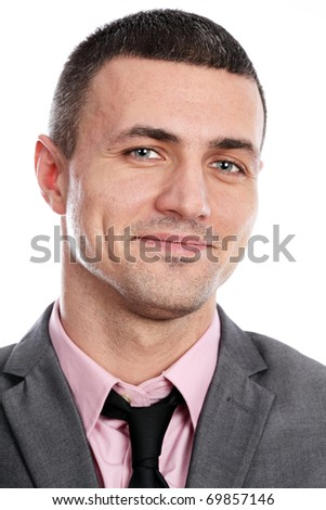 Portrait of a handsome young happy businessman in suit over white background - stock photo