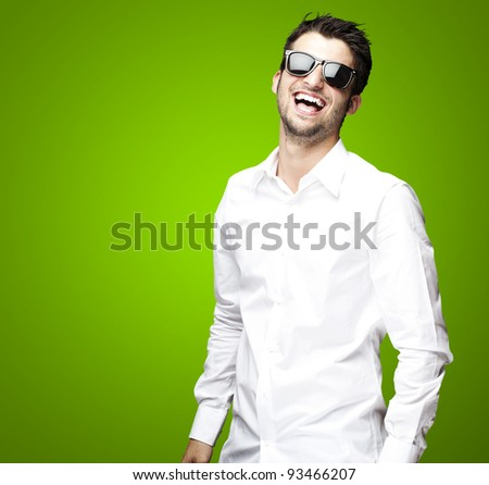portrait of a handsome young man enjoying over green background