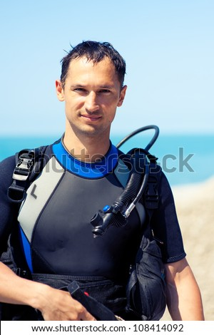 Portrait of a handsome young man in a diving suit
