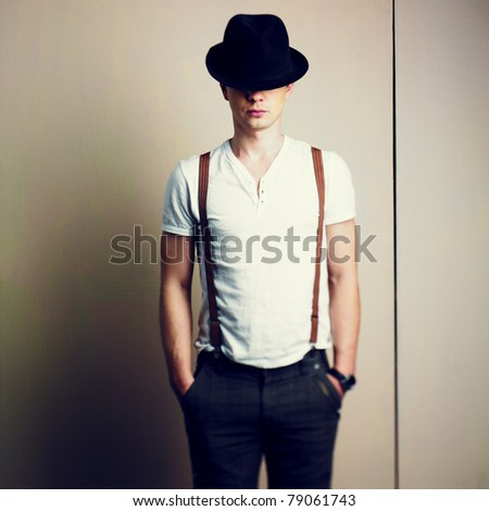 Portrait of a handsome young man in hat