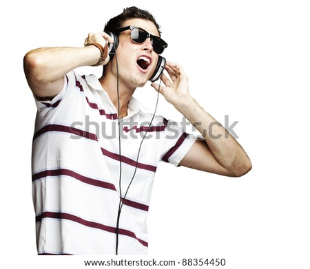 portrait of a handsome young man listening to music over white background