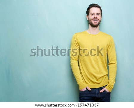 Shutterstock Portrait of a handsome young man smiling against blue background
