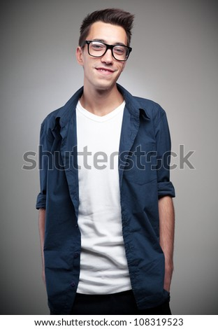 Portrait of a handsome young man standing with his hands in pocket