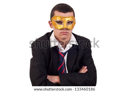 portrait of a handsome young man wearing a Venetian mask - stock photo