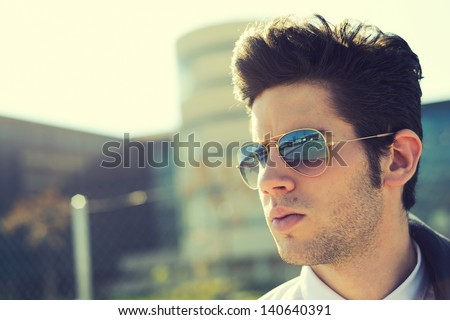 Portrait of a handsome young man with sunglasses