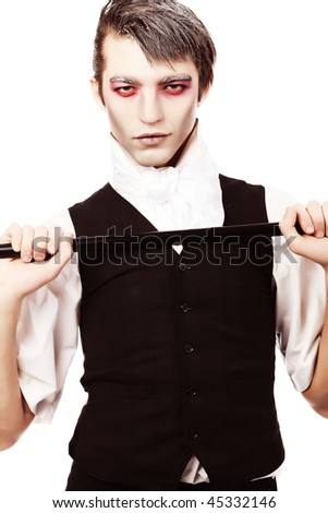 Makeup on Portrait Of A Handsome Young Man With Vampire Style Make Up  Shot In A