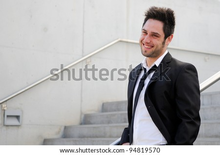 Portrait of a handsome young smiling business man