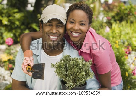 Portrait of a happy African American couple gardening together