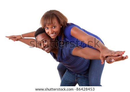 Portrait of a happy african american couple having fun together against white background