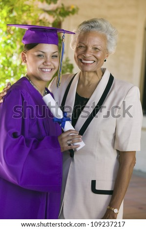 Portrait of a happy African American graduate with grandmother during graduation day