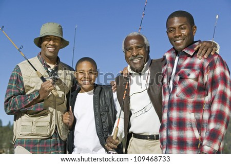 Portrait of a happy African family holding fishing rods